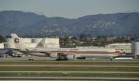 B-6052 @ KLAX - Taxiing to gate at LAX - by Todd Royer