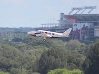 N100P @ TPA - PA-31-350 taking off at Tampa with Raymond James (Tampa Bay Buccaneers NFL team) Stadium in background - by Florida Metal