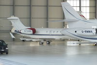 M-EANS @ LSGG - YH Aviation Challenger 300 in the Jet Aviation hangar - by Chris Hall