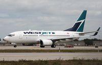 C-FMWJ @ KFLL - Boeing 737-700 - by Mark Pasqualino