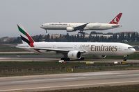 A6-ECB @ LTBA - Line-up rwy 35L; TC-JJO is approaching rwy 05 after flight from JFK - by Jens Achauer