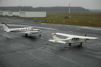 D-IADE @ EDHL - Cessna 340A and a Cessna P210R Centurion parked at  Lübeck Blankensee airport, Germany. - by Henk van Capelle
