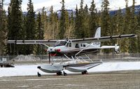 C-FDJH @ CYXY - In the south parking area at Whitehorse, Yukon. - by Murray Lundberg