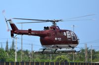 PT-HXJ @ SBME - BO105 of Helivia taking-off from MEA - by FerryPNL