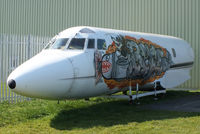 N25AG @ EGBP - outside the ASI hangar painted with some intresting graffiti artwork - by Chris Hall