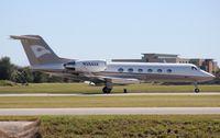 N394AK @ ORL - Gulfstream IV (with a Hawker logo on tail????)