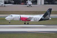 N412XJ @ TPA - Silver Saab 340
