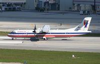 N414WF @ MIA - American Eagle ATR-72 since been retired