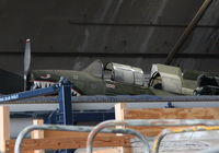 N2039A @ KFFO - Stuffed up on a high shelf in the restoration facility - by Glenn E. Chatfield