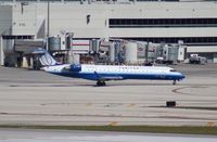 N519LR @ MIA - United Express CRJ-700