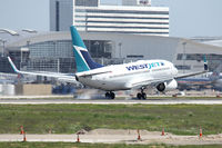 C-FWSY @ DFW - WestJet's first flight landing at DFW Airport - by Zane Adams