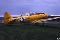 N86057 @ EVY - ex RCAF 20476 Harvard IV  with pseudo DE-ANG tail marks - by John Hevesi