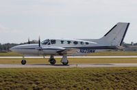 N629WM @ ORL - Cessna 421C leaving NBAA