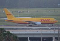 N788AX @ MCO - DHL 767-200 early morning arrival