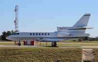 N827CT @ ORL - Falcon 50 leaving NBAA