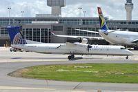 N332NG @ KIAD - Taxiing for departure - by Robert Kearney