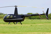 G-FCUM @ EGBT - being used for ferrying race fans to the British F1 Grand Prix at Silverstone - by Chris Hall