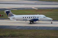 N87557 @ TPA - United Express B1900D