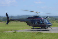 G-TFHW @ EGFP - Bell 206B, spooling down on the apron at Pembrey. - by Derek Flewin