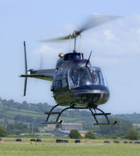 G-TFHW @ EGFP - Bell 206B operated by Fly Heli Wales Ltd ready to set down at Pembrey. - by Derek Flewin
