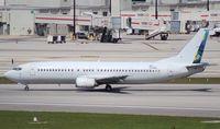 N238AG @ MIA - Fly Guam (Sky King) 737-400
