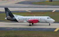 N348AG @ TPA - Silver Saab 340