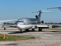 N410BN @ OPF - Private 727 about to be broken up