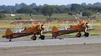 N707TJ @ EGFH - Breitling wing Walkers Display Team on stand at EGFH, also seen is, SE-BOG. - by Derek Flewin
