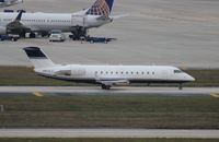 N601LS @ TPA - Challenger 850 (corporate CRJ-200)