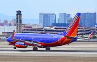 N233LV @ KLAS - N233LV Soutthwest Airlines   2006 Boeing 737-7H4 C/N 32501  N886EP  1996 Raytheon  400A C/N RK-117  McCarran International Airport (KLAS) Las Vegas, Nevada TDelCoro July 12, 2013 - by Tomás Del Coro