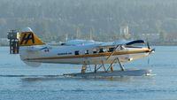 C-GUTW @ CYHC - Harbour Air #302 with an early morning departure in Coal Harbour. - by M.L. Jacobs
