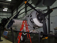 74120 @ KBDL - The New England Air Museum's newly acquired Wildcat receives some attention.  This aircraft actually served aboard the SS Mission Bay (CVE-59) in the Atlantic Theater. The FM-2 was a General Motors-built aircraft with aerodynamic improvements over the F-4 - by Daniel L. Berek