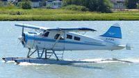 C-FJFQ @ CYVR - Van City Seaplanes #200 taxiing to takeoff position on the Fraser River. - by M.L. Jacobs