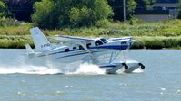 C-FTEL @ CYVR - Private Telus Kodiak taking off on the Fraser River. - by M.L. Jacobs