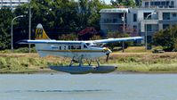 C-GLCP @ CYVR - Harbour Air #311 landing on the Fraser River. - by M.L. Jacobs