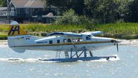 C-GLCP @ CYVR - Harbour Air #311 taxiing to the Fraser River terminal. - by M.L. Jacobs