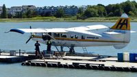 C-GLCP @ CYVR - Harbour Air #311 being refueled at the YVR Seaplane Terminal. - by M.L. Jacobs