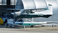 C-FCUK @ CYVR - Private Cessna parked at the Harbour Air hangar at South Terminal. - by M.L. Jacobs