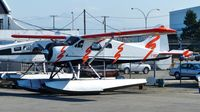 C-GEZS @ CYVR - Private DeHavilland Beaver parked at Harbour Air hangar. - by M.L. Jacobs