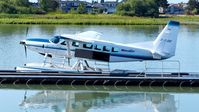 C-FJOE @ CYVR - Seair Seaplanes Cessna tied at the dock on the Fraser River. - by M.L. Jacobs