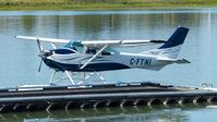 C-FTNI @ CYVR - Van City Seaplanes Cessna docked at Fraser River terminal. - by M.L. Jacobs