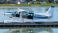 C-FLAC @ CYVR - Seair Seaplanes Cessna at the Fraser River terminal dock and ready for the next flight. - by M.L. Jacobs