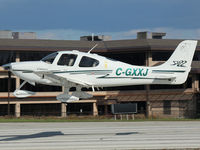 C-GXXJ @ YKZ - 2003 Cirrus SR22 landing on runway 33 at Buttonville, Ontario (YKZ) - by Ron Coates