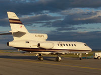 C-GGFP @ CYXR - This nice bizjet looked cool as it was being pushed into its hangar for the night after landing at sunset. - by Chris Coates
