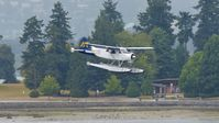 C-FWAC @ CYHC - Harbour Air #219 landing in Coal Harbour on a rainy morning. - by M.L. Jacobs
