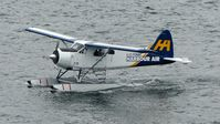 C-FWAC @ CYHC - Harbour Air #219 taxiing to the terminal in the rain. - by M.L. Jacobs