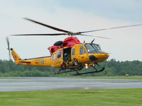 146491 @ YPQ - This 1997 Bell Griffon RCAF Rescue helicopter lands in Peterborough, Ontario for fuel. - by Ron Coates
