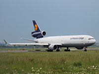 D-ALCS @ YYZ - Lufthsansa Cargo MD 11F holding short of runway 23 at YYZ Toronto Int'l Airport - by Ron Coates