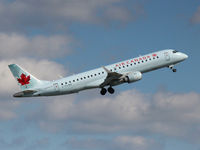 C-FLWH @ CYYZ - This 2007 Embraer 190 climbs off runway 05 at Toronto Int'l Airport (YYZ) - by Ron Coates