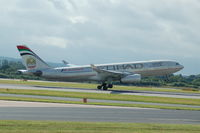 A6-EYS @ EGCC - Etihad Airbus A330-243 taking off from Manchester Airport. - by David Burrell